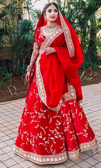 red sabyasachi lehenga , red designer lehenga , red lehenga , sabyasachi bride in red