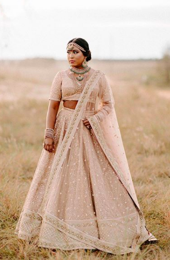 nri wedding , nri sabyasachi bride , pastel sabysachi lehenga design 2020