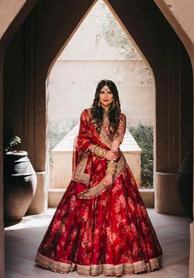 red bride , red sabyasachi lehenga